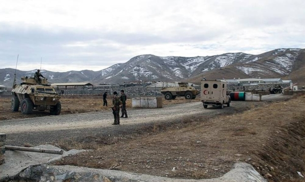An ambulance is seen parked at the scene of the terror attack at an Afghan army base in Ghazni province in eastern Afghanistan.