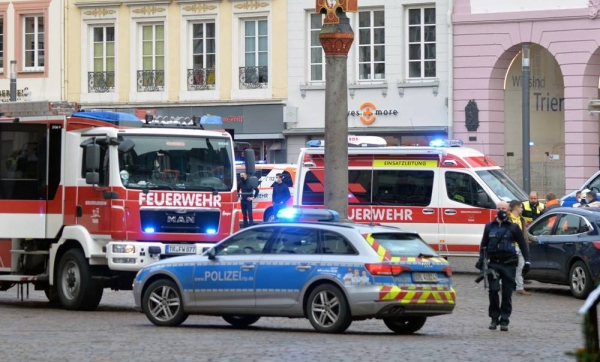 Police in the western German town of Trier secure the area after a driver plows into pedestrians on Tuesday.