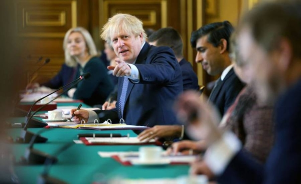 Boris Johnson, seen chairing a Cabinet meeting, faces a rebellion among UK MPs from his Conservative Party over planned new restrictions in England to combat the coronavirus pandemic.