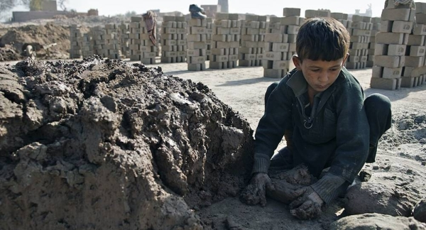 A seven-year-old child working at a brick kiln in Nangarhar province, Afghanistan. His family indebted to the kiln's owner. — courtesy UNICEF/Noorani