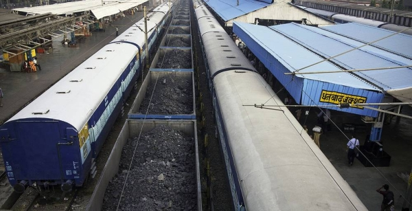 A new report has urged countries to cut the production of fossil fuels by 6 percent, per year, to avoid catastrophic global warming. Pictured here, a cargo train, laden with coal, waits at a railway station in India. File photo courtesy ESCAP Photo/Christian Dohrmann