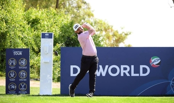 Andy Sullivan of England plays his tee shot on the ninth hole during Day One of the Golf in Dubai Championship at Jumeirah Golf Estates on Wednesday in Dubai, United Arab Emirates. — courtesy photo by Ross Kinnaird/Getty Images)