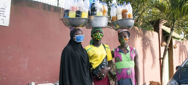 Three young women wearing masks are selling medicine on the street during the COVID-19 crisis in Abidjan, Côte d'Ivoire. — Courtesy photo