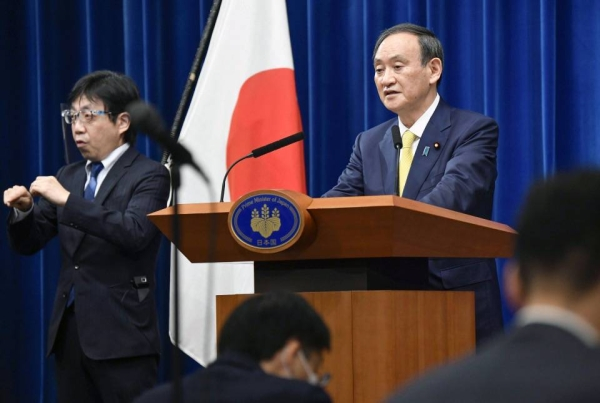 Japanese Prime Minister Yoshihide Suga speaks in Tokyo on Friday at a press conference marking the end of an extraordinary parliament session. — courtesy Kyodo