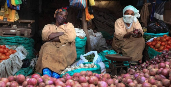 Street vendors sell vegetables at a market in Addis Ababa, Ethiopia. — courtesy UNICEF/NahomTesfaye