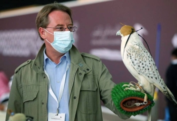 French Ambassador Ludovic Pouille seen holding a falcon during his visit to the King Abdulaziz Falconry Festival on Saturday.