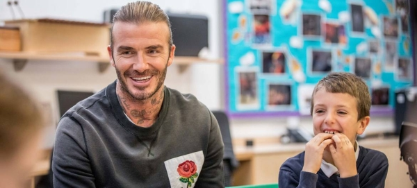 The former English football star and UNICEF Goodwill Ambassador David Beckham, pictured here at a school in London, UK, has supported the agency's work across the world. — Courtesy photo