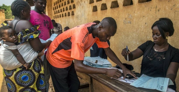 An official processes voter ID cards, ahead of the 27 December general elections in the Central African Republic. — courtesy MINUSCA/Hervé Serefio