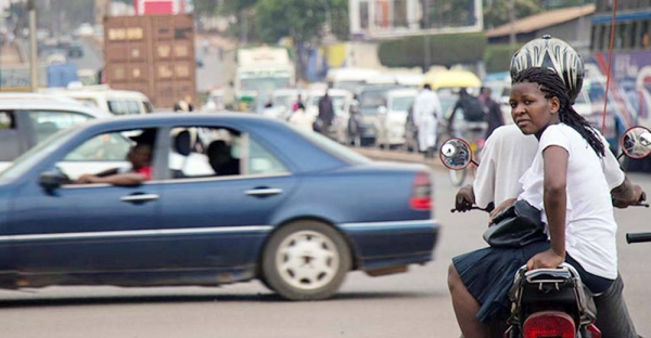 A Boda Boda rider and passenger wait at a junction in Kampala, Uganda. — courtesy World Bank/Sarah Farhat