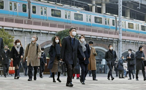 Commuters head to work from Shimbashi Station in Tokyo on Thursday morning. — courtesy Kyodo