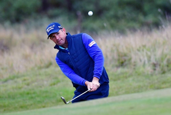 Padraig Harrington of Ireland plays his third shot on the 18th hole during the first round of the Scottish Championship presented by AXA at Fairmont St Andrews on Oct. 15, 2020 in St Andrews, Scotland. — courtesy  Mark Runnacles/Getty Images