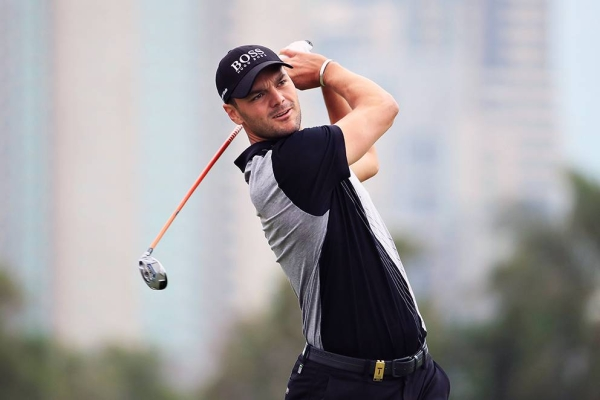 Martin Kaymer of Germany plays his second shot on the thirteenth hole during Day Two of the Omega Dubai Desert Classic at Emirates Golf Club on Jan. 24, 2020 in Dubai, United Arab Emirates. (Photo by Andrew Redington/Getty Images)