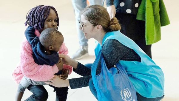 File photo shows a UNHCR staffer welcoming resettled refugees originally from Syria and South Sudan at Lisbon airport in Portugal. — courtesy UNHCR/José Ventura