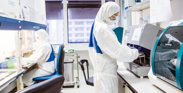 Laboratory technicians work at a viral zoonoses research center in Bangkok, Thailand. — courtesy WHO/P. Phutpheng