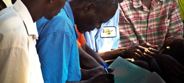 This file picture shows a community group meeting in Uganda. — Courtesy photo