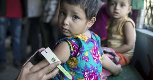 A child is tested for malnutrition at a UNICEF-supported health clinic in Bangladesh. According a UN report, malnutrition among young children and infants remains a pervasive problem in South Asia. — courtesy UNICEF/Siegfried Modola