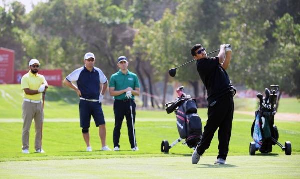 Ali Saif Bin Sumadia of the UAE plays a shot as Padraig Harrington of Ireland watches on during the pro am ahead of the Abu Dhabi HSBC Championship at Abu Dhabi Golf Club on Wednesday in Abu Dhabi, United Arab Emirates. (Photo by Ross Kinnaird)