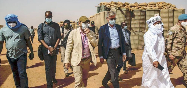 UN peacekeeping chief Jean-Pierre Lacroix, in center with sunglasses, visited Ménaka, Mali, where he met with the governor, president of the Interim Authority, armed groups signatories to the peace agreement, civil society and the local commander, among others. — courtesy MINUSMA