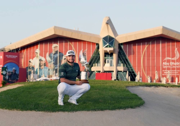 Tyrrell Hatton of England poses for a photograph with the trophy following victory during Day 4 of the Abu Dhabi HSBC Championship at Abu Dhabi Golf Club on Sunday in Abu Dhabi, United Arab Emirates. (Photo by Warren Little)