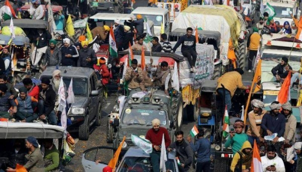 Farmers protest during a tractor rally near the Singhu border crossing in Delhi, India, on Tuesday. — Courtesy photo