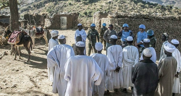 File photo shows UNAMID peacekeepers interact with local community members during a routine patrol in Siri Sam village, Central Darfur. — courtesy UNAMID/Mohamad Almahady
