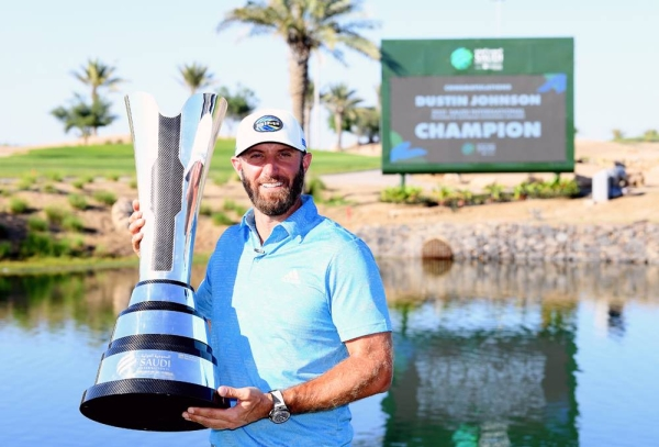 Dustin Johnson of the USA with the winners trophy after the final round of the Saudi International powered by SoftBank Investment Advisers at Royal Greens Golf and Country Club on Sunday in King Abdullah Economic City, Saudi Arabia. (Photo by Ross Kinnaird)
