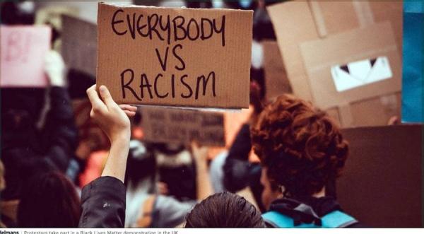 Protestors take part in a Black Lives Matter demonstration in the UK. — courtesy Unsplash/Arthur Edelmans