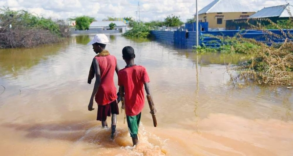 Young boys walk through a section of a flooded residential area in Belet Weyne, Somalia. — courtesy UN Photo/Ilyas Ahmed