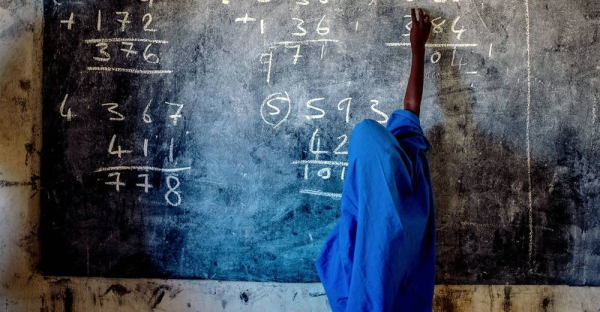 A young girl writes on a chalkboard at a primary school in Nigeria. — courtesy UNICEF/Apochi Owoicho