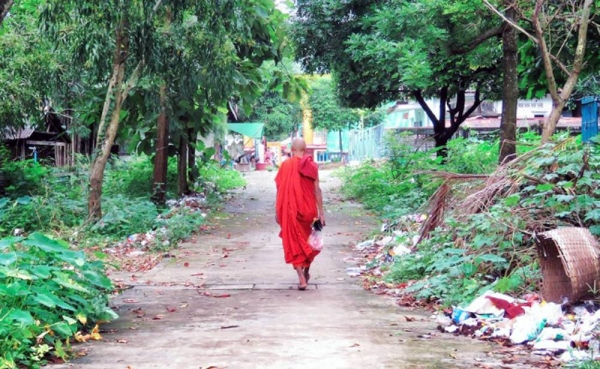 A monk walks toward a pagoda temple near Yangon, Myanmar. — courtesy Unsplash/Anika Mikkelson