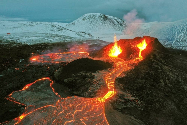 Steam and lava spurted Monday from a new fissure at an Icelandic volcano that began erupting last month.