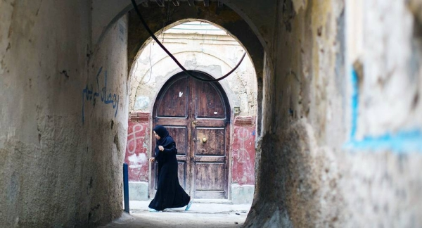 File photo shows a woman walking in the old city of Tripoli, Libya. — courtesy UNSMIL/Lason Athanasiadis