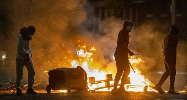 Masked youths hijacked and set on fire a bus in West Belfast on Wednesday night as the Northern Irish capital was rocked by the sixth night of violence. — Courtesy photo