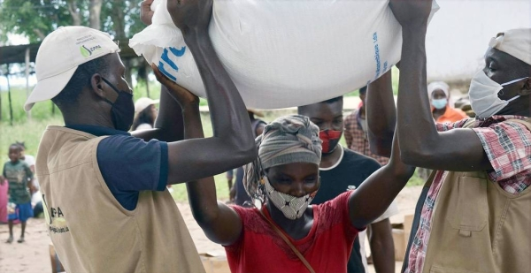 A displaced woman in northern Mozambique receives food aid. — courtesy WFP/Grant Lee Neuenburg