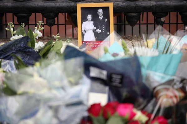 Floral tributes are left outside Buckingham Palace following news of Prince Philip's death. — courtesy PA
