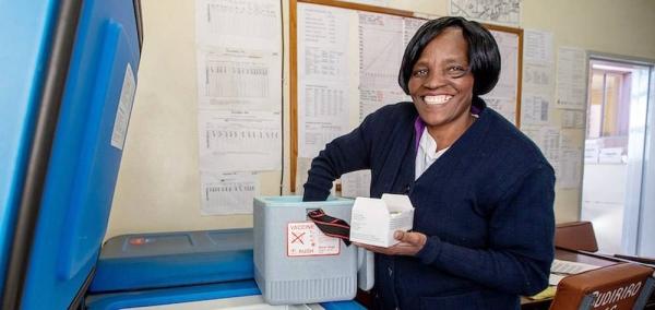 Nurse Merjury Mayoyo stores vaccines in a dedicated solar-powered refrigerator at the Budiriro Clinic in Zimbabwe. — courtesy UNDP/Karin Schermbucker