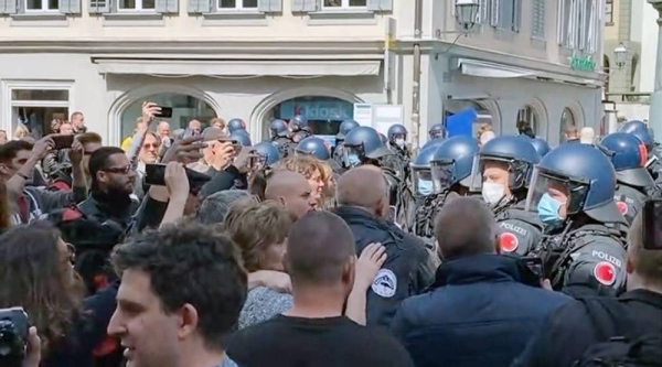 A video grab of Swiss protestors facing up to police in the capital city as many others took to the streets to protest COVID-19 restrictions in other European capitals.