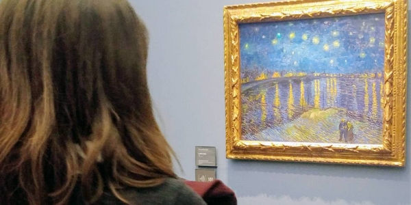 Woman at Musée d'Orsay in Paris gazes at Vincent Van Gogh painting from 1888. — courtesy UN News/Elizabeth Scaffidi