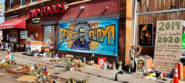 Tributes are left for George Floyd outside the grocery store in the US state of Minnesota where he was murdered by a police officer in this file courtesy photo.
