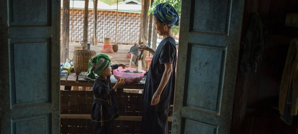 According to WFP, food prices have risen sharply since the start of the political crisis in Myanmar. A grandmother washes vegetables to prepare a meal at her home in the country's Shan state in this file photo.