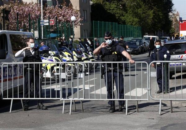 President Emmanuel Macron named the victim as