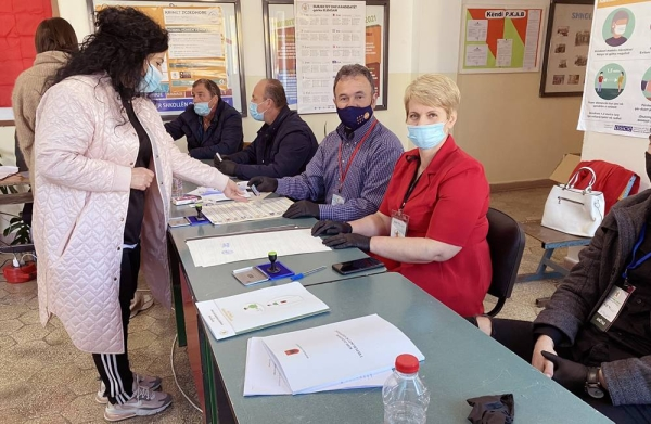 A voter goes to a poll center as Albanians cast their vote Sunday amid the COVID-19 pandemic.