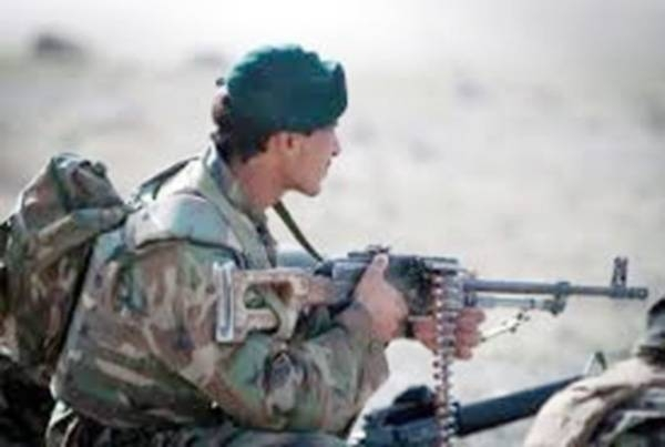A member of the Afghan security forces is standing guard.