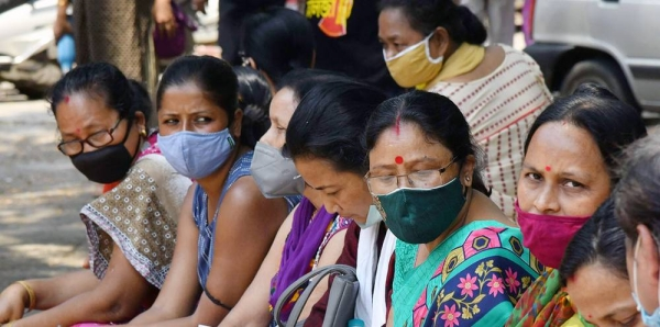 People wait for a COVID-19 vaccination at a state dispensary in Guwahati, India, on April 29, 2021. — courtesy UNICEF/Biju Boro