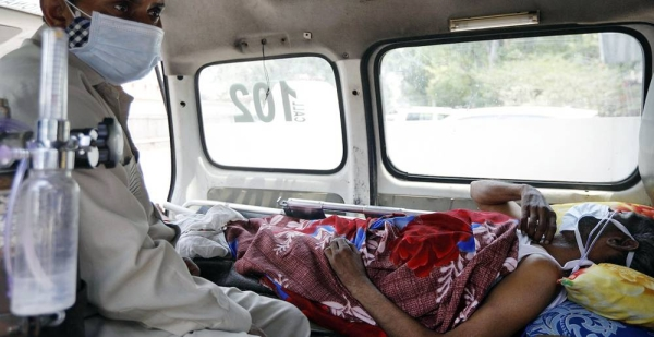 A COVID-19 patient waits inside an ambulance for a bed at a hospital in New Delhi, India. — courtesy UNICEF/Amarjeet Singh
