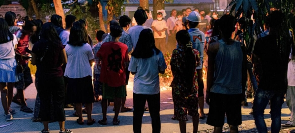 People are seen holding a vigil in Yangon, Myanmar, in this file photo.