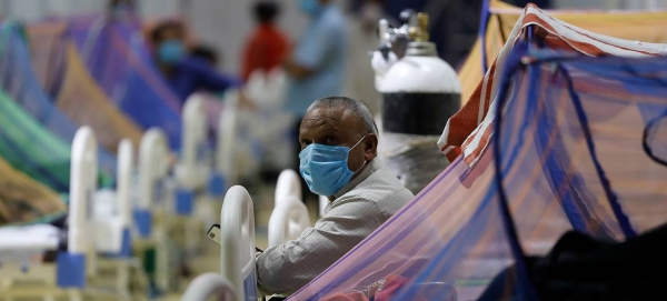 Patients receive treatment in the COVID-19 care center at the Commonwealth Games Village (CWG) in New Delhi in this file courtesy photo
