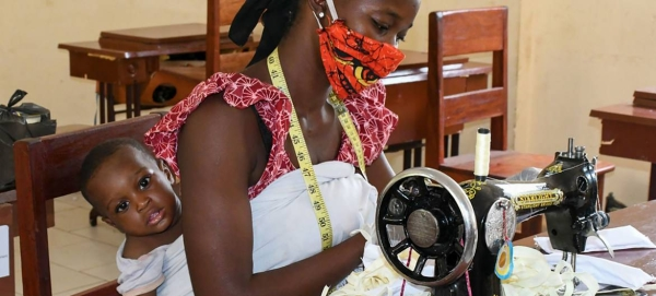 A woman in Guinea turns her sewing skills into mask-making during the COVID-19 crisis in this courtesy file photo.