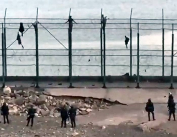 A videograb of Spanish police rounding up the migrants from Morocco, who arrived in the Spanish enclave of Ceuta between Monday and Tuesday.