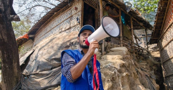 Mohammad Alam, a Rohingya refugee, has been working with IOM to keep his community informed following the fire at Cox's Bazar. — courtesy IOM/Mashrif Abdullah Al